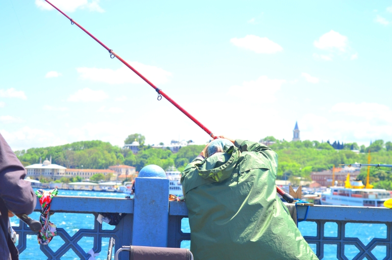 Fishing lady on Galata Bridge Istanbul colorful photography